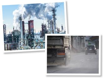 工場、煙をまき散らして走るトラック